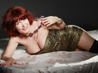 Webcam model RedheadRita69 from XLoveCam
